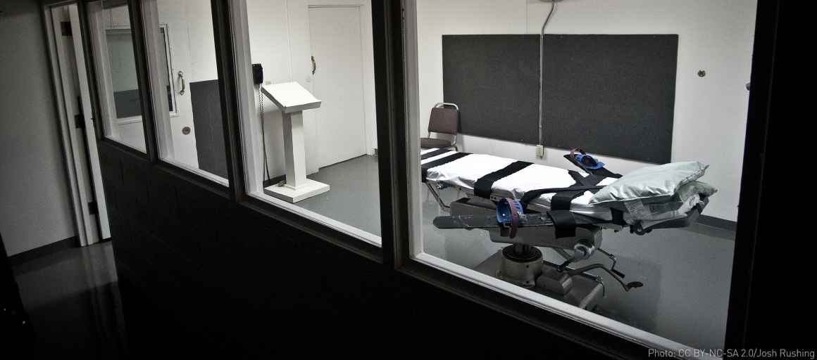 Empty lethal injection execution chamber with injection table and podium